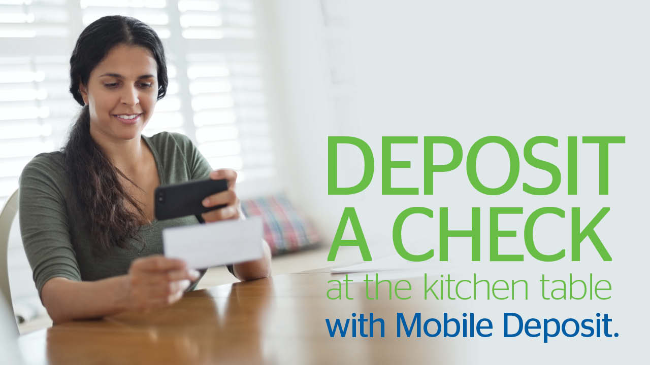 Deposit a check at the kitchen table with Mobile Deposit.