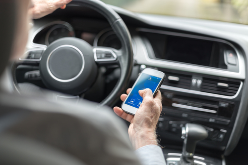 car driver with cell phone