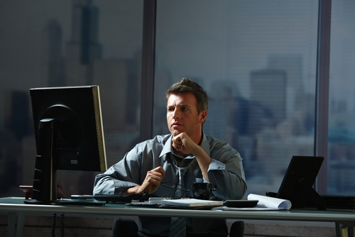 man working in office at night